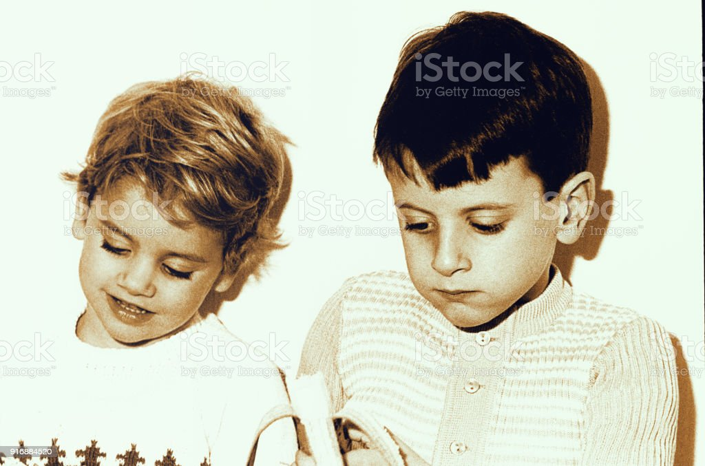 Vintage kids eating bananas stock photo