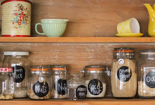 vintage kitchen hutch with baking ingredients - bloem stapelvoedsel stockfoto's en -beelden