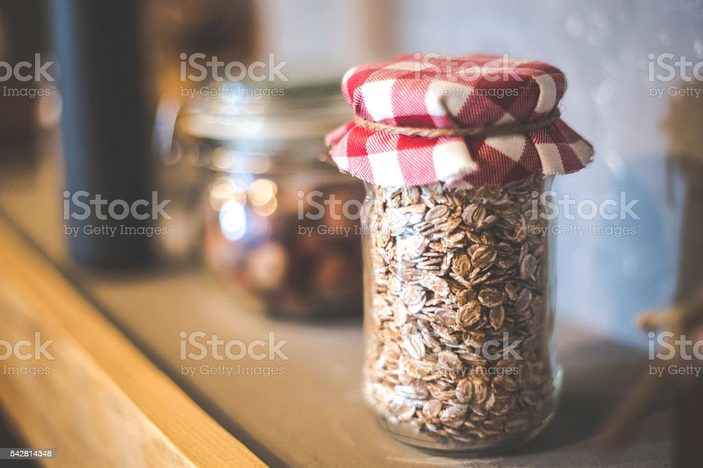 Vintage Kitchen Hutch With Ingredients In Jars Royalty Free Stock Photo
