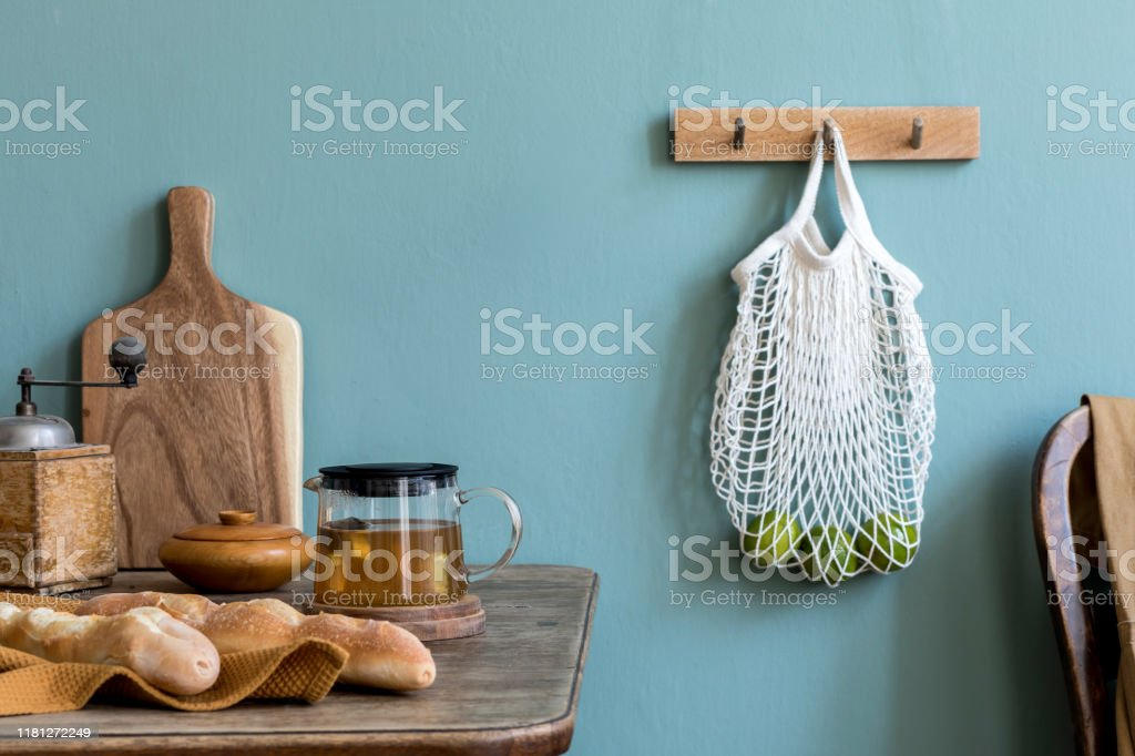 Vintage Kitchen Interior With Wooden Table Bag With Vegetables Bagles Cup Of Tea And Kitchen Accessories Minimalistic Concept Of Kitchen Space Country Side Mood Template Eucalyptus Color Stock Photo Download Image