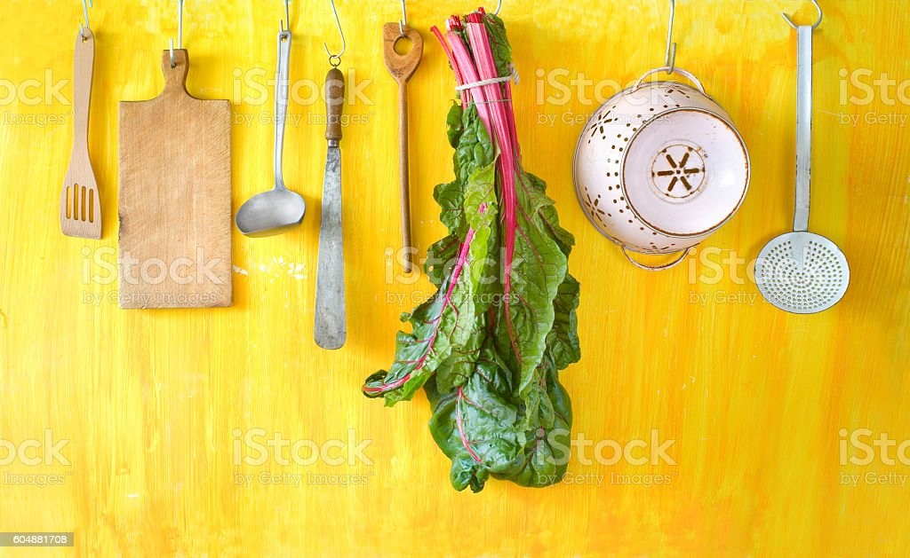 vintage kitchen utensils and  Swiss chard vegetable Lizenzfreies stock-foto