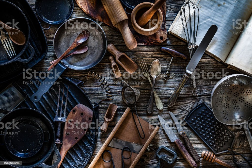 Large group of vintage kitchen utensils shot from above on rustic...