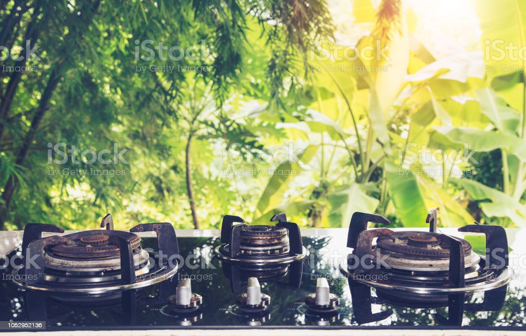 Vintage Kitchen Utensils. outdoor kitchen with Gas Stove an...