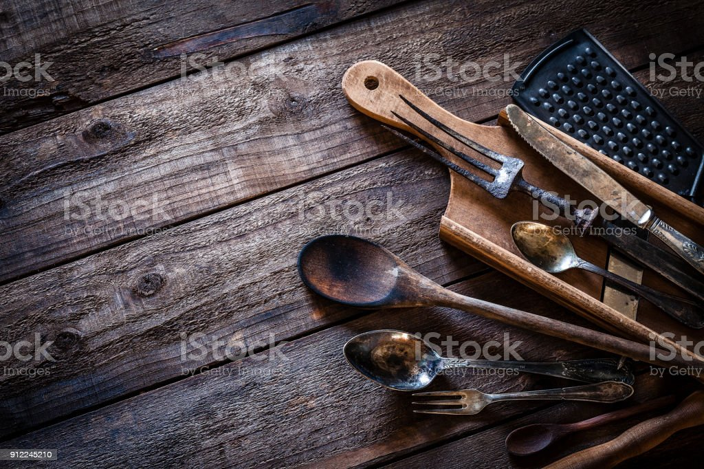 Vintage Kitchen Utensils Shot From Above On Rustic Wooden Table  Royalty Free Stock Photo