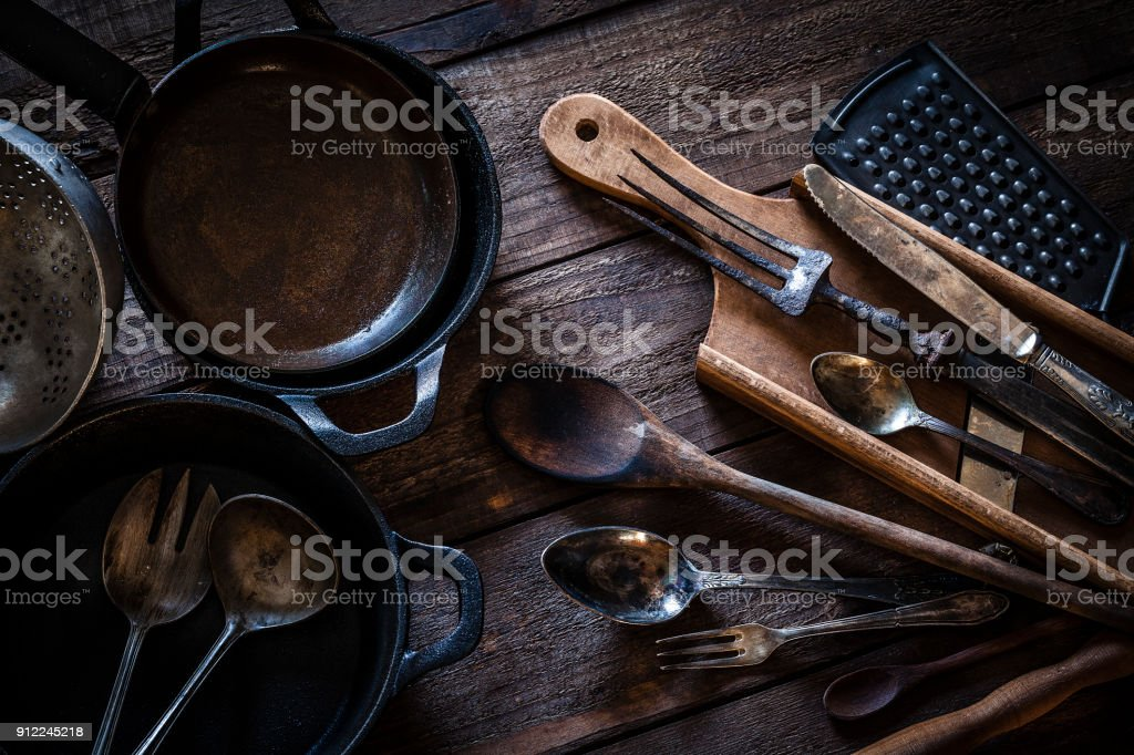 Vintage kitchen utensils shot from above on rustic wooden table stock photo