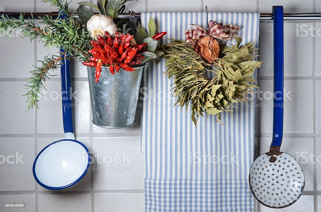 Vintage kitchen wall with rag, spoons and spices stock photo