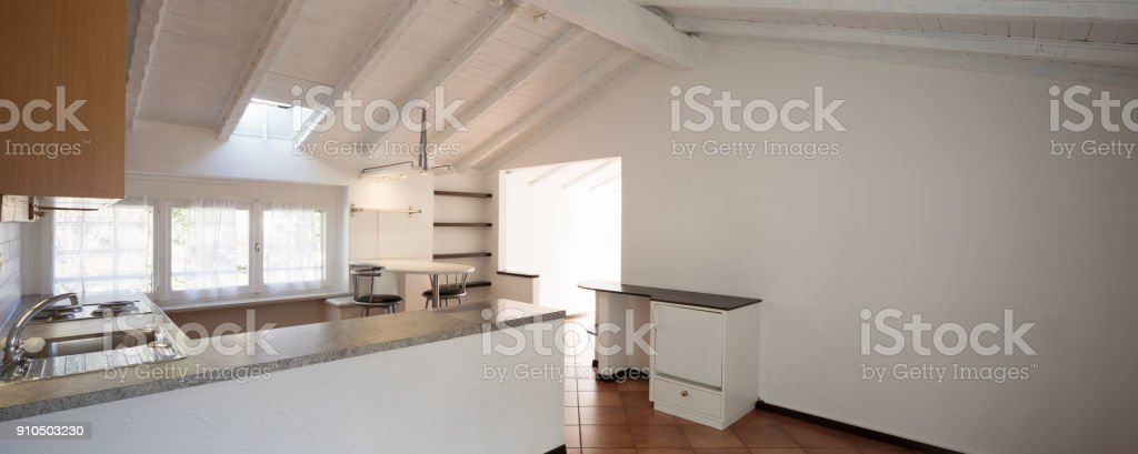 Front view of vintage kitchen with wooden furniture. Three small...