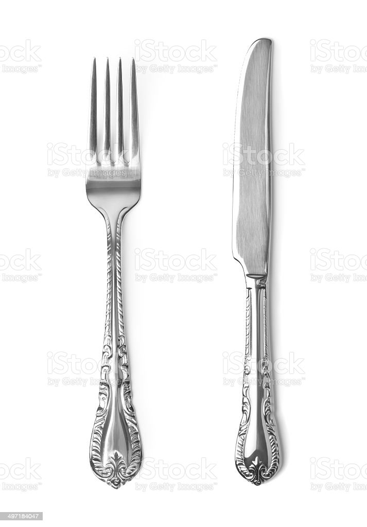 Vintage knife and fork on white background stock photo