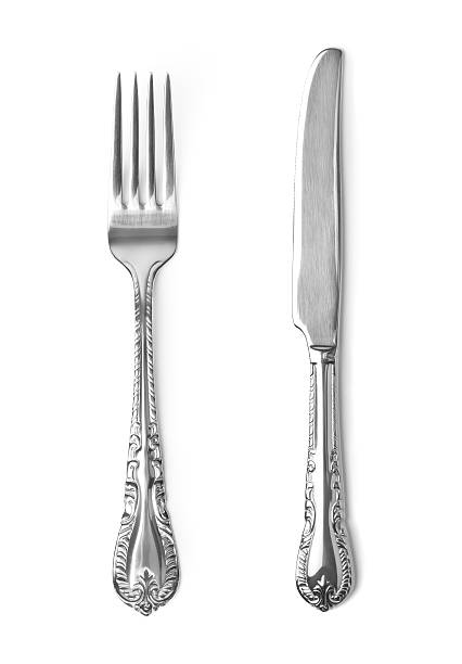 vintage knife and fork on white background - table knife stock photos and pictures