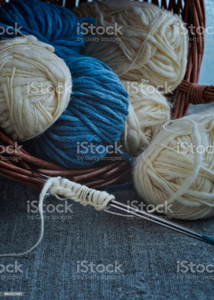 Vintage Knitting Needles and Yarn on a Wooden Background stock photo
