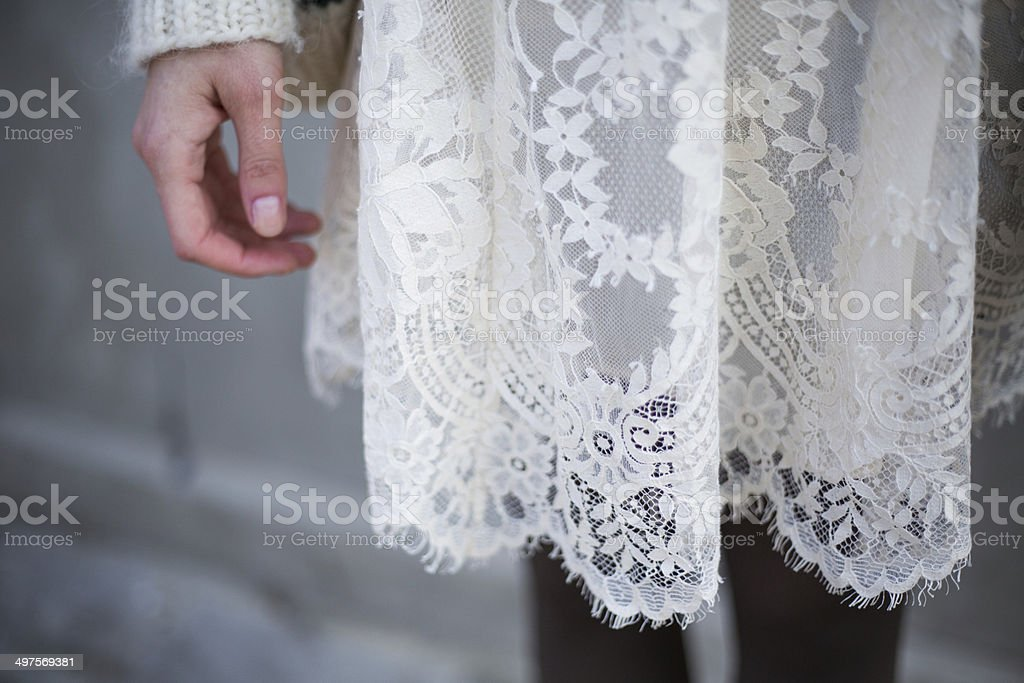 Vintage lace dress with knitted cardigan stock photo