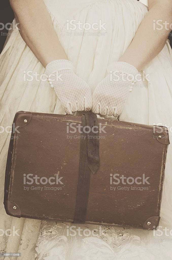 Vintage lace gloves and suitcase stock photo