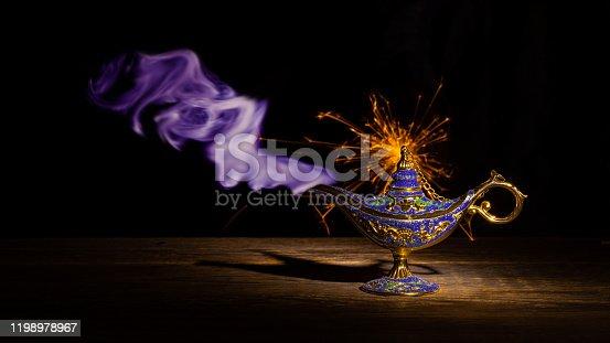 Vintage lamp of Aladdin on black background