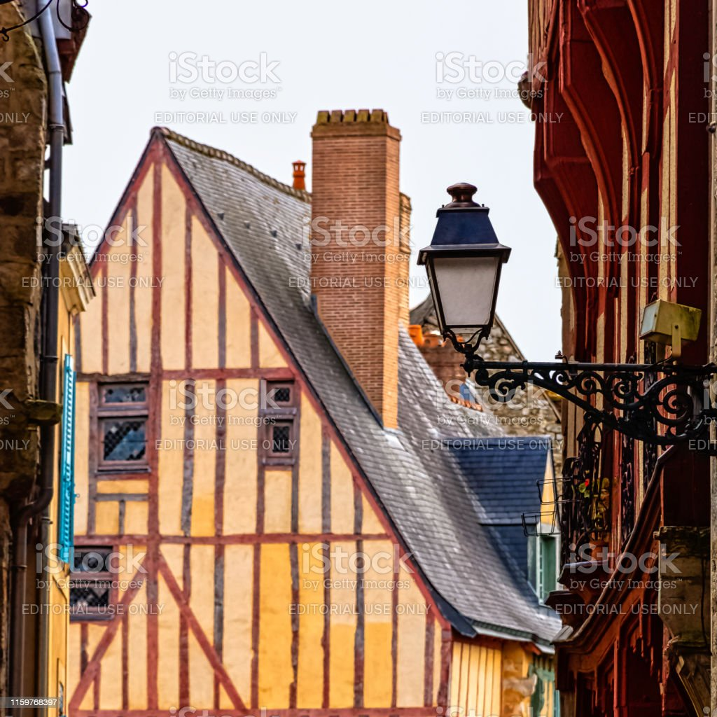 Architecte Le Mans vintage lamp with architecture of old town in background le