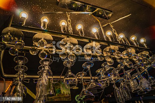 1013514594 istock photo Vintage lamps with blurred liquor bar stock photo 1180166155