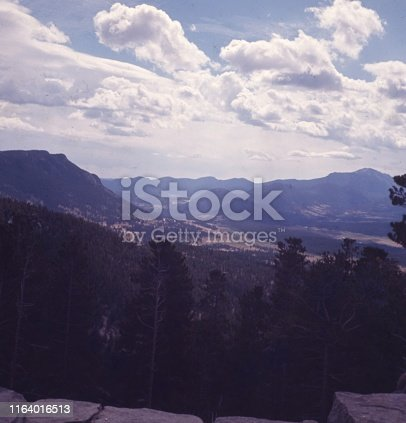 Vintage, authentic archival photograph of landscape of mountains and clouds, 1965
