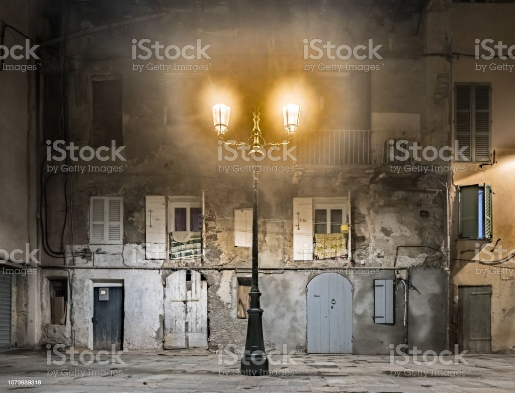Vintage lantern against old wall in europe stock photo