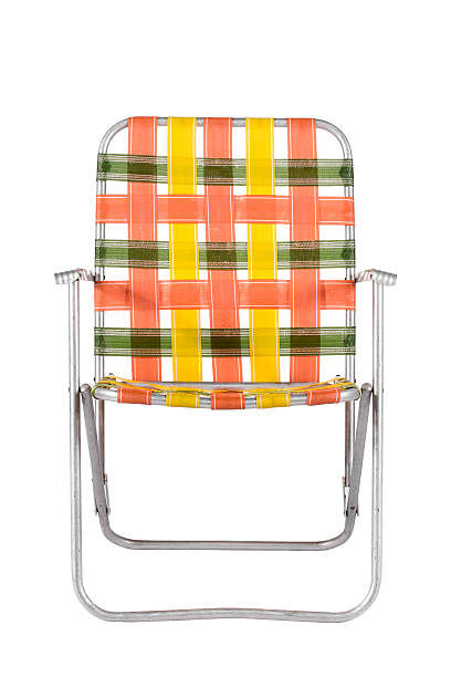 Vintage Lawn Chair Head On Orange and green strapped aluminum lawn chair like your parents used to have. Isolated on white. foldable stock pictures, royalty-free photos & images