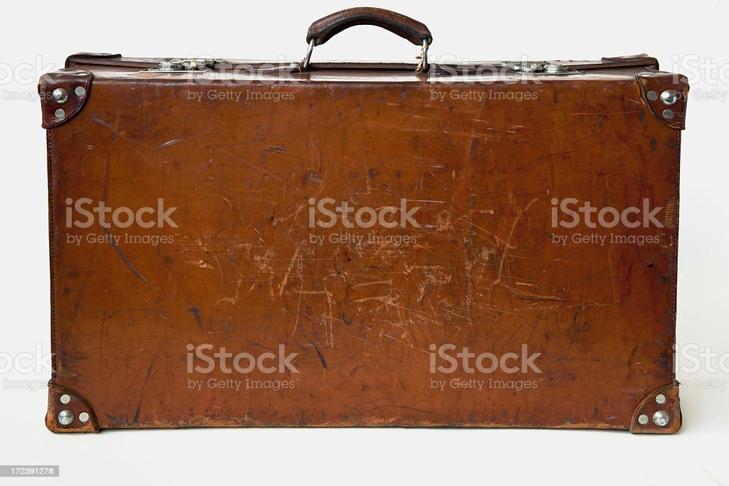 Mala de couro Vintage em pé no chão. - foto de acervo