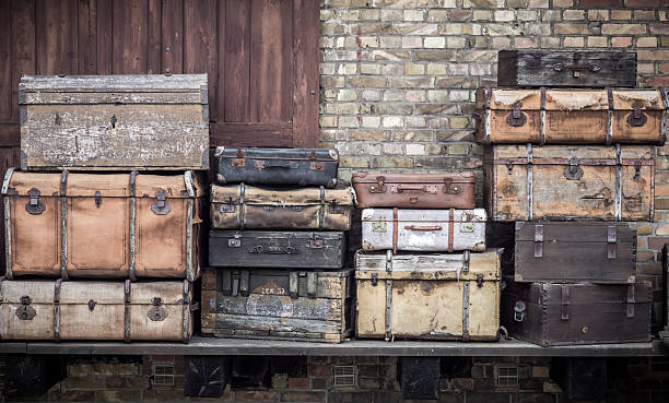 vintage leather suitcases stacked vertically - spreewald, germany. - deko koffer stock-fotos und bilder