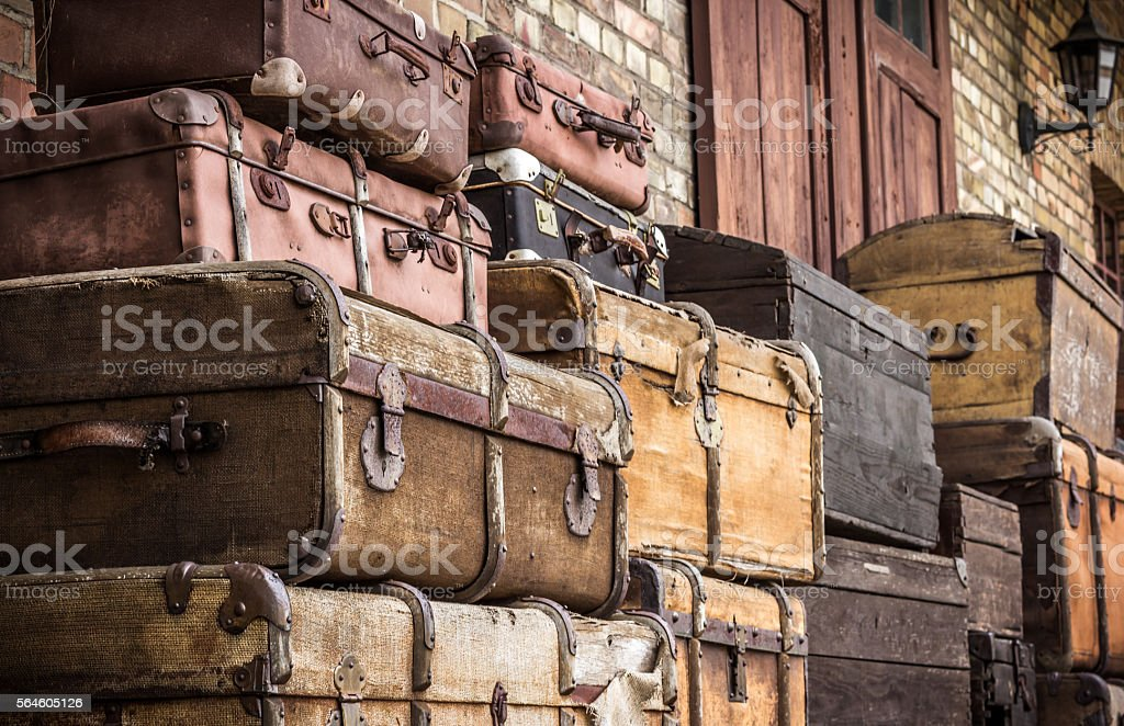 Vintage leather suitcases stacked vertically - Spreewald, Germany. stock photo