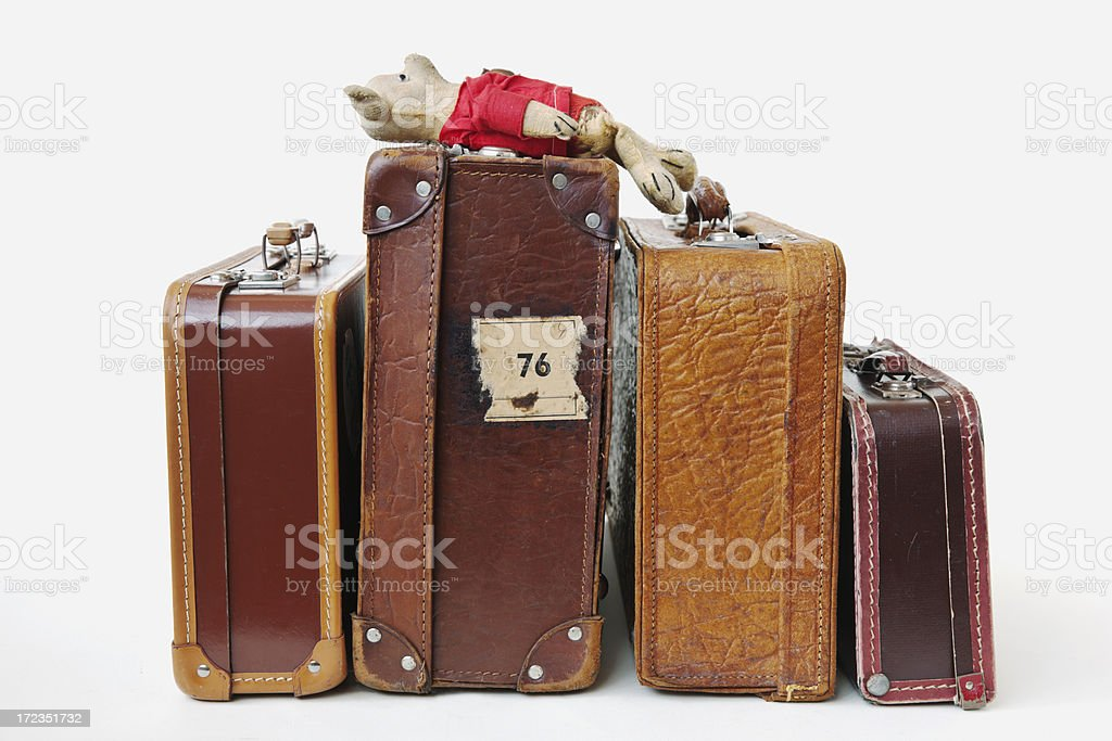 Vintage leather suitcases  with lying  worn plush teddy bear. royalty-free stock photo