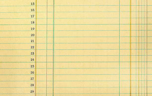 Vintage Ledger Paper Closeup of yellow numbered ledger paper accounting ledger stock pictures, royalty-free photos & images