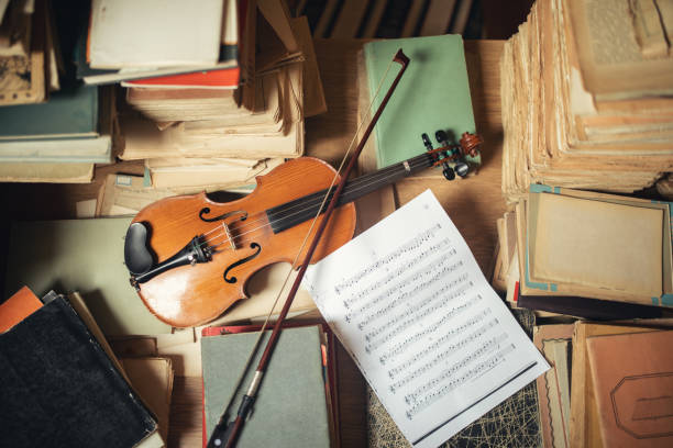 Vintage library still life with violin stock photo