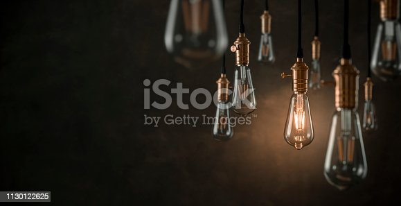 Vintage light bulbs over dark background with copy space
