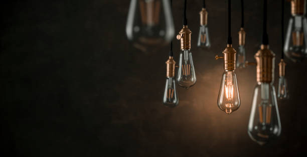 vintage light bulbs over dark background with copy space - light bulb stock pictures, royalty-free photos & images