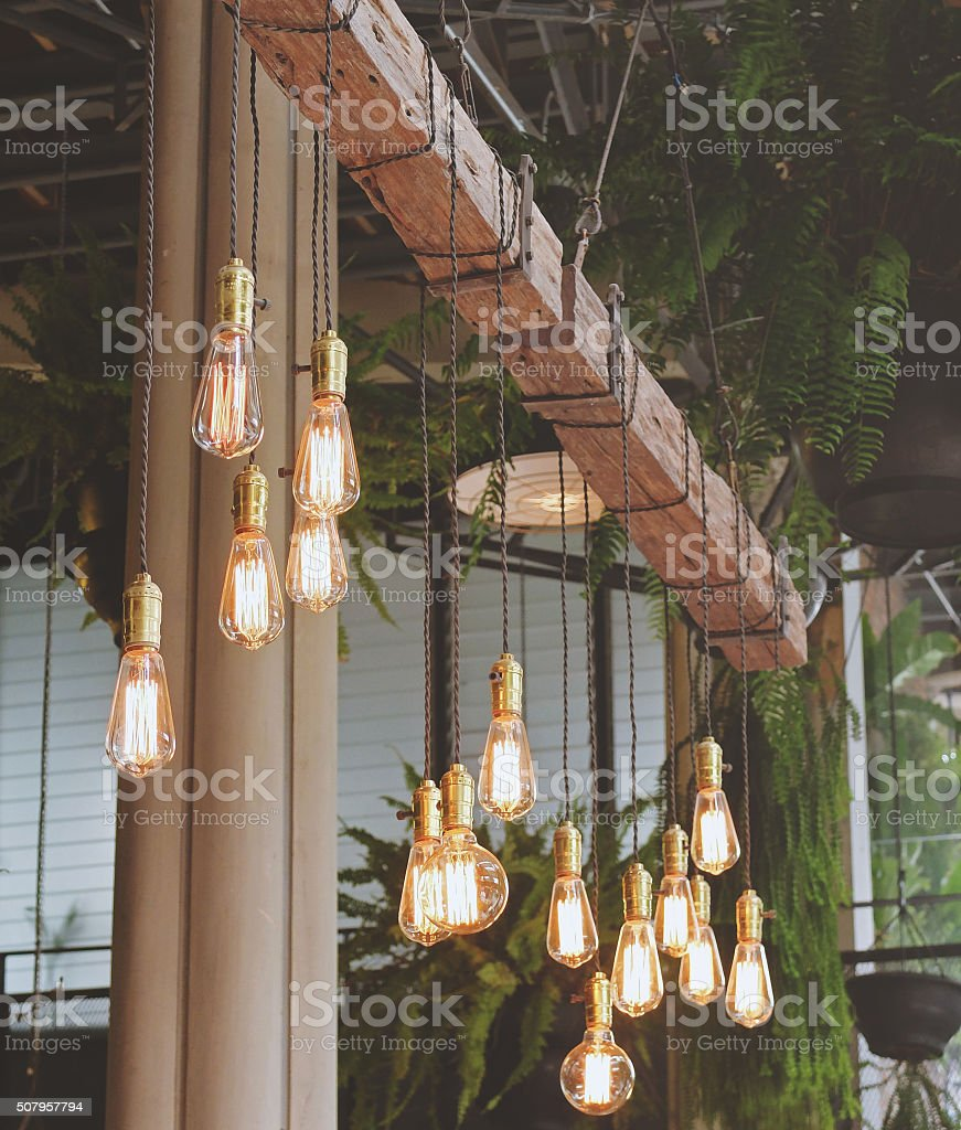 Vintage lighting decor in the cafe with retro filter toned stock photo