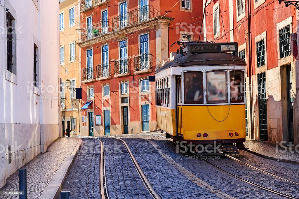 Vintage Lisbon tram on city street stock photo