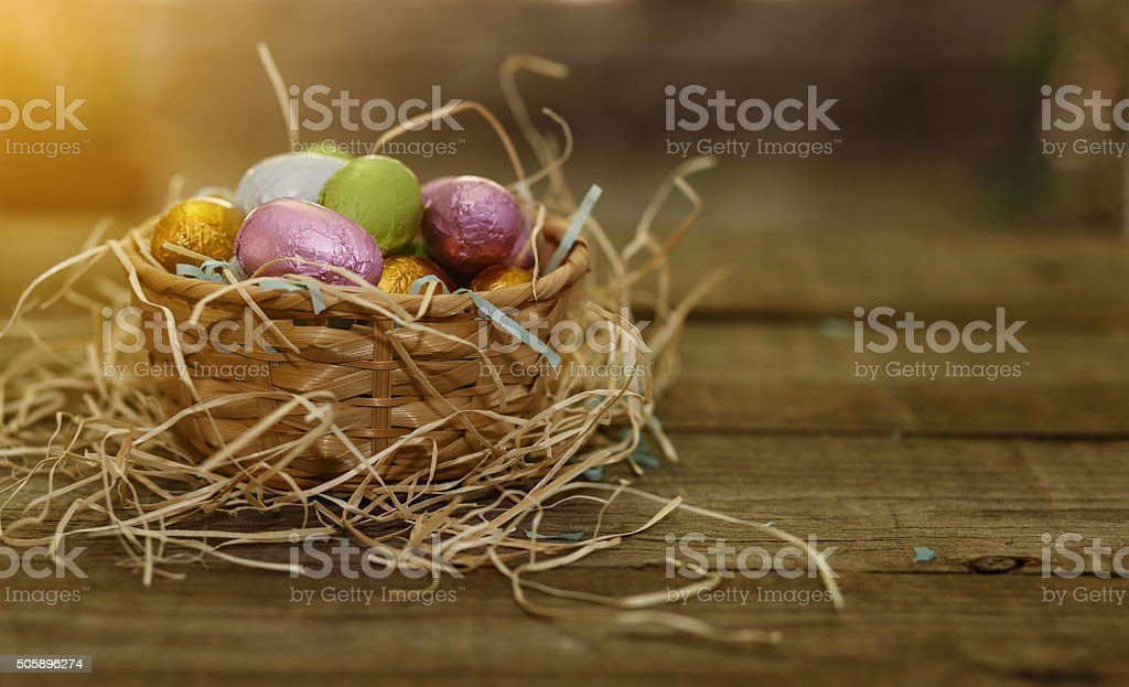 Vintage looking image of Easter chocolate eggs over natural back stock photo