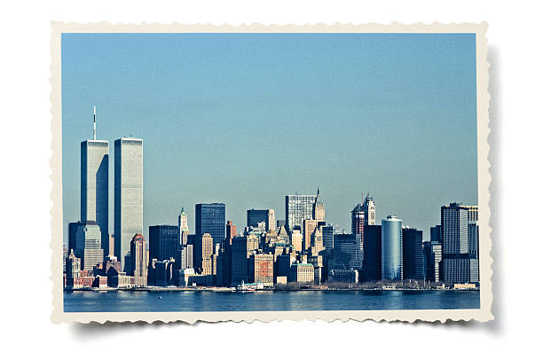 Vintage Lower Manhattan skyline Retro-styled colour photo (my own, taken February 1988) of Lower Manhattan skyline, including the Twin Towers, layered on a serrated photo border with added vintage effects. Isolated on white with a soft shadow. Clipping path provided for the serrated edge outline. Photo scanned from 35 mm slide film (Kodachrome 64). manhattan financial district stock pictures, royalty-free photos & images
