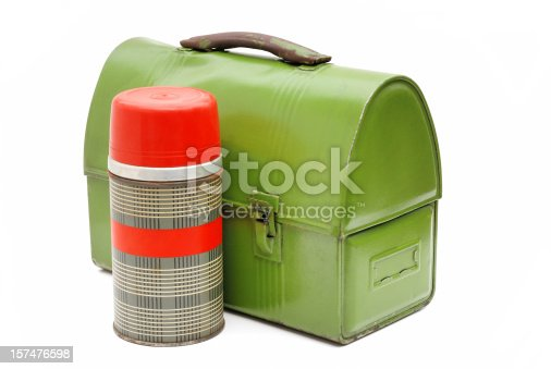 Vintage school or workman's metal lunch box, slightly battered, dented and rusting alongside a vintage half sized thermos.