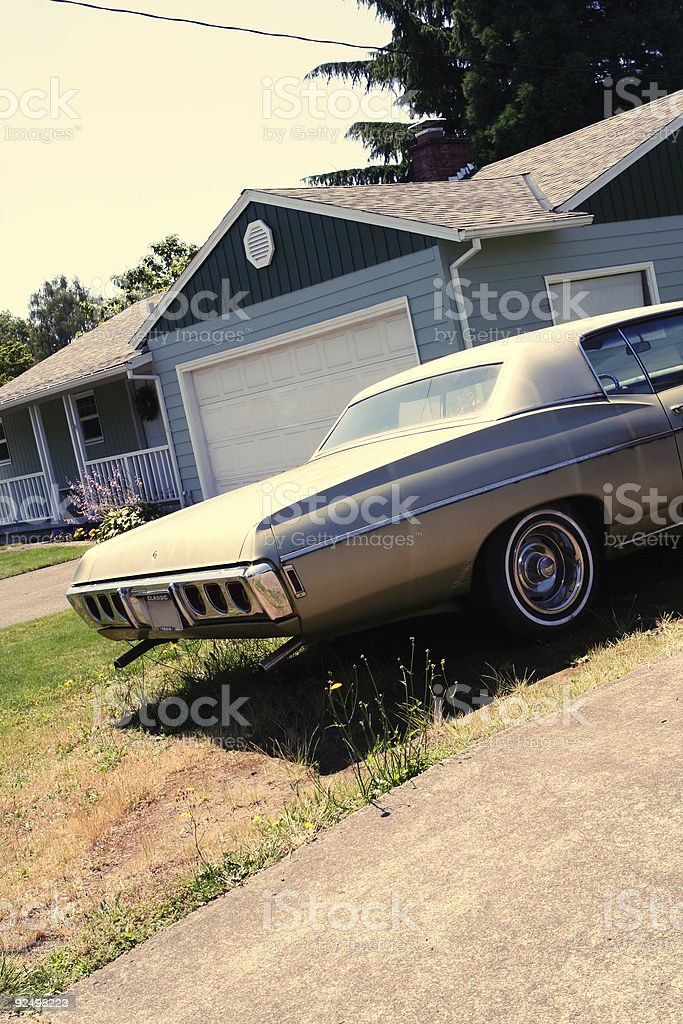 Vintage Luxury Car Parked in the Yard royalty-free stock photo