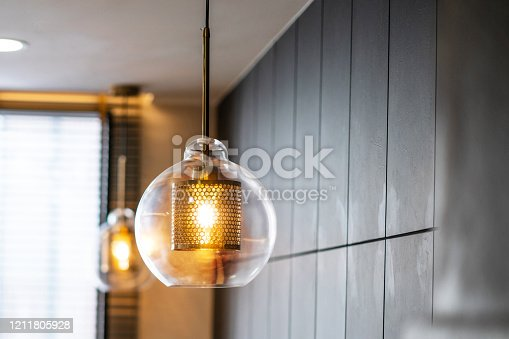940992564 istock photo Vintage luxury interior lighting lamp cover with bronze plate an 1211805928