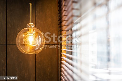 940992564 istock photo Vintage luxury interior lighting lamp cover with bronze plate and transparent glass bulb for home decor. 1211375543