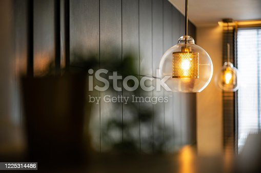 940992564 istock photo Vintage luxury interior lighting lamp cover with bronze plate and transparent glass bulb for home decor. 1225314486