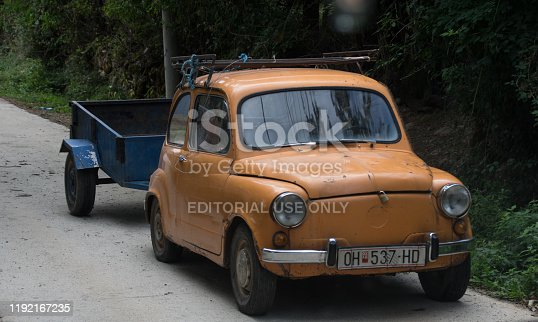 Ohrid, Macedonia, - September 23, 2019. Vintage car with trailer in the village street