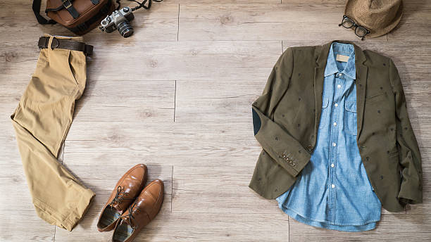 Vintage male clothing and accessories on the wooden background stock photo