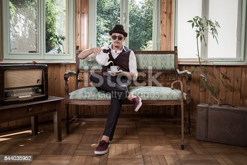 Vintage man drinking tea