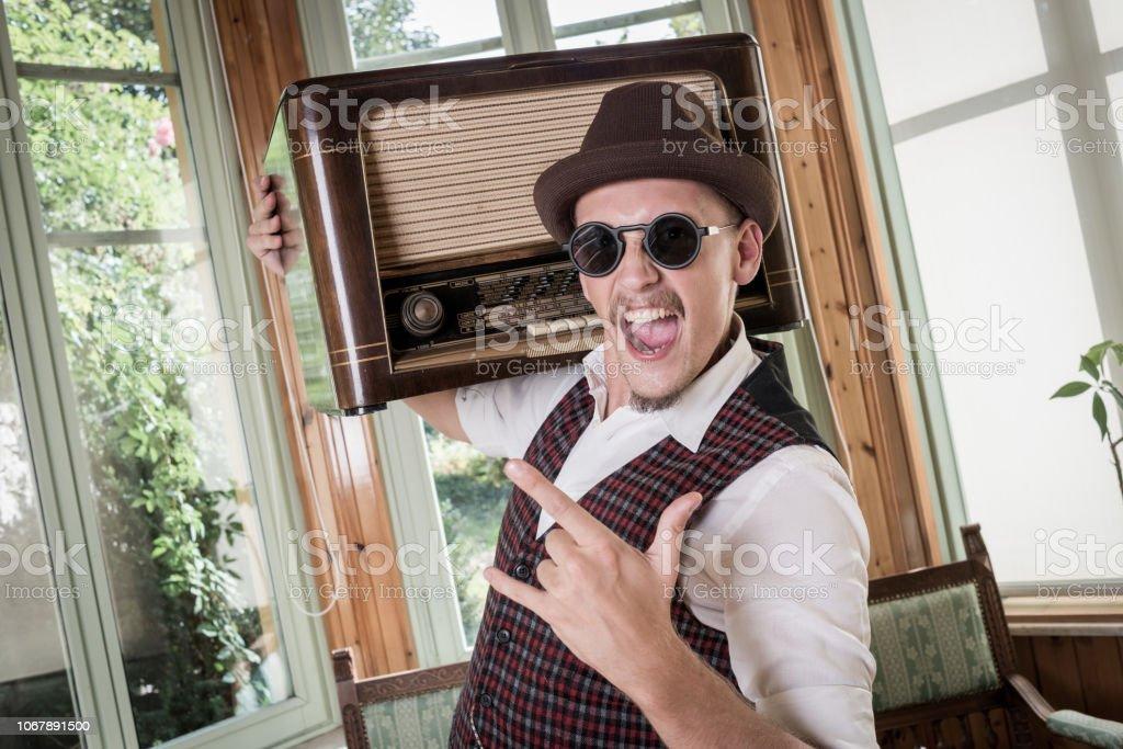 Vintage man listening to his radio