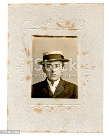 Portrait of a young man wearing a boater hat from the later Victorian or early Edwardian period.