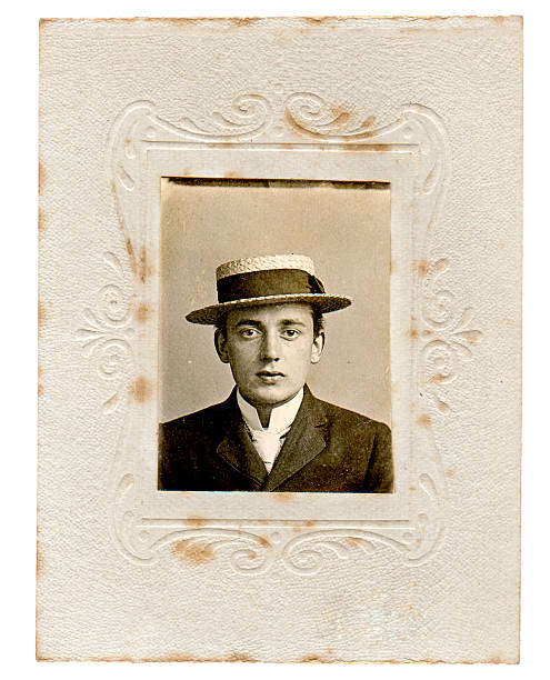 Vintage man Portrait of a young man wearing a boater hat from the later Victorian or early Edwardian period. edwardian style stock pictures, royalty-free photos & images