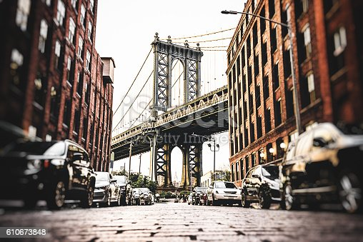 istock Vintage manhattan bridge in new york 610673848