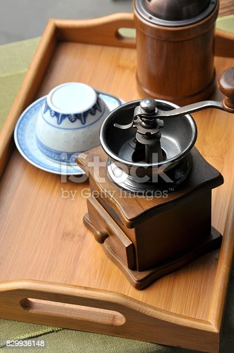 Vintage manual coffee grinder and Chinese teaset