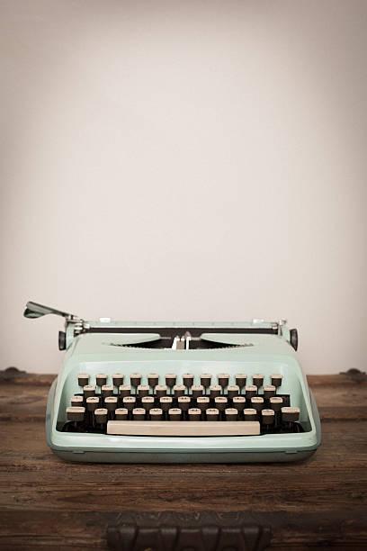 Vintage Manual Typewriter on Wood Trunk, Light Teal stock photo