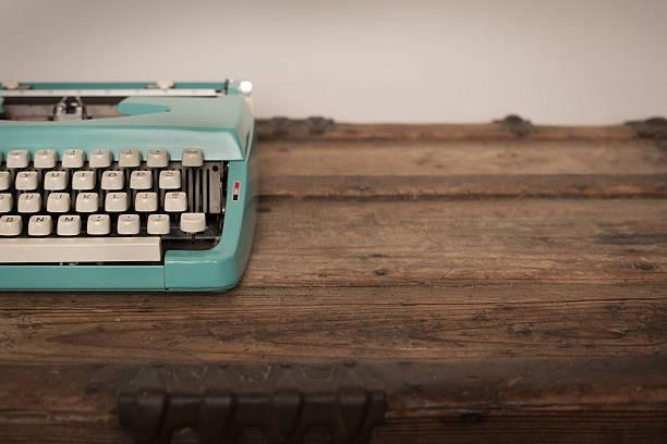 Vintage Manual Typewriter on Wood Trunk, Teal stock photo