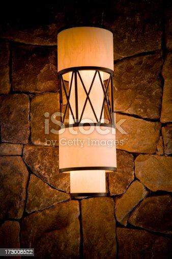 vintage mau light / a lantern on a stone wall / lighting up the night